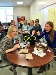 Edmunds Elementary School teachers Pam Maxwell, left, and Jessica Webb enjoy their Teacher Appreciation Week lunch provided to the school by Iowa Methodist Hospital.