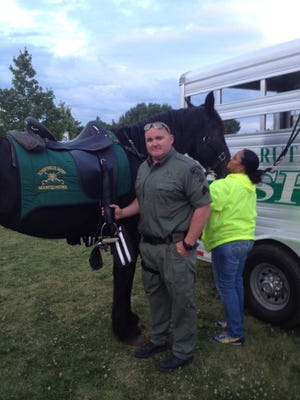 Sgt. Jon Levi shows his Percheron mare Lushey to the Sheriff's Citizens Academy class.