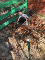 Cumberland County 4-H member Jordan Marie Rambo lends a hand in cleaning up the Cumberland County Fairgounds on May 24.
