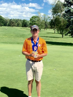 Bronxville's Connor Daly poses with the trophy after winning the NYSPHSAA boys golf championship at the Robert Trent Jones Golf Course in Ithaca.