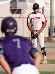 Naa'taanii pitcher Arjay Miller stares down the Storm's Brock Beckstead at third base on Tuesday at the Piedra Vista baseball field.