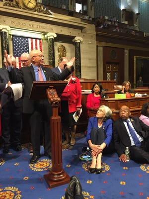This photo provided by Rep.Suzanne Bonamici, D-Ore. shows Democrat members of Congress, including, from left, Rep. Peter DeFazio, D-Ore., Rep. Katherine Clark, D-Mass., and Rep. John Lewis, D-Ga.,participating in sit-down protest seeking a a vote on gun control measures, Wednesday, June 22, 2016, on the floor of the House on Capitol Hill in Washington.