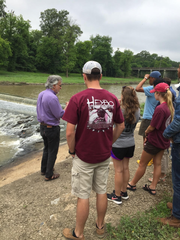 Dr. Ochs explains the function of the weir just outside of Clarksdale.