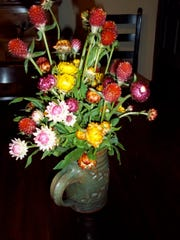 With some rustic containers, flowerpots, vases and