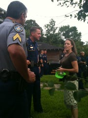 Sister Alison McCrary, president of the Louisiana chapter of the National Lawyers Guild, asks representatives of the Louisiana State Police and Baton Rouge Police Department to negotiate an end to a standoff with demonstrators Sunday, July 10, 2016.