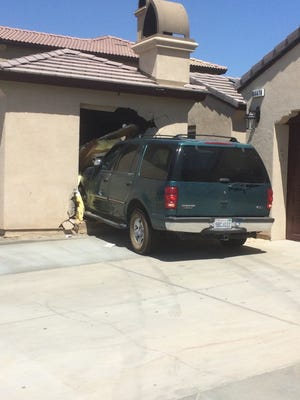 A dark green Ford Expedition crashed into a home in the 84400 block of Redondo Norte in Coachella Monday morning. The driver fled the scene, officials said.