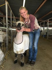 Taylor Kemp, age 14, has taken care of sheep most of