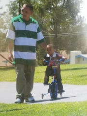 "Julian ""J.T."" Melendrez with his son, Estevan, on his son's birthday in 2010. Melendrez was shot and killed in March 2011 in Las Cruces."