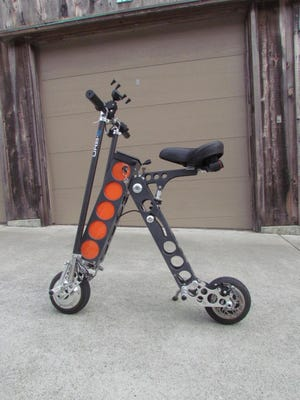 The scooter folds to fit in a car trunk, or can be carried on a transit train or bus. It unfolds for riding as far as 20 miles at speeds of up to 15 mph.