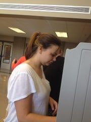 Siegel senior Hailey Clemons casts a practice ballot