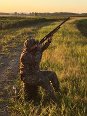 Jeffrey Davis points his gun to the sky hoping to shoot a dove.