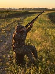 Jeffrey Davis points his gun to the sky hoping to shoot