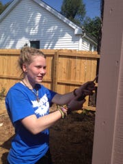 Holloway senior Kealy Cox leans about community service