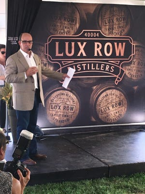 Luxco CEO Donn Lux unveils the company's Bardstown distillery name.