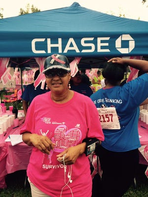 Ira D. Brown at the Chase tent at the Northeast Louisiana Susan B. Komen Race for the Cure. She was diagnosed with breast cancer in February.`