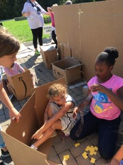 Kalia Brown, right, wants to be an architect or an engineer, and she got her start Friday helping her Extended School Program classmates from Overall Creek construct a movie theater.