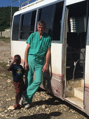 Dr. Fosnes poses with one of the students from a previous mission trip.