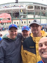 Steve Vernon of Ithaca, far left, and his friend Khris Nevins, second from right in yellow, are traveling to Chicago to watch Saturday's World Series game from a bar in Wrigleyville. The two are seen here during a spring trip to a Cubs game in Chicago.
