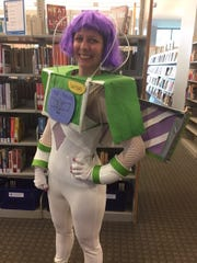 Rachel Inabinet, a Greenville County library employee, dressed a Buzz Lightyear for Halloween.