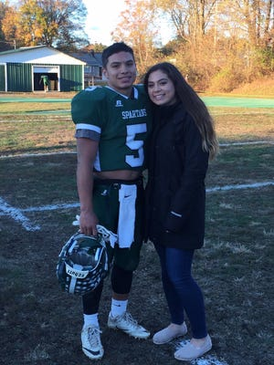 Spackenkill football player Camron Abalos and his sister, Bailee Abalos, a Spackenkill volleyball player, pose together.