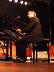 Iowa City native and professional pianist Chase Garrett will host the seventh annual Boogie Woogie Piano Stomp at The Englert Theater this weekend.  Special to the Press-Citizen OLYMPUS DIGITAL CAMERA