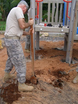 Members of an Air Force construction squadron including Norris Burkes do humanitarian work in Panama.