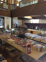 Oakland library director Peter Havel surveys used books