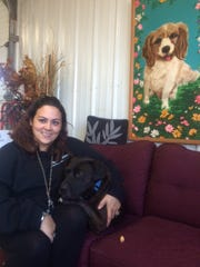 Maria Ochs hugs her dog Bronco. Ochs opened Neenah's