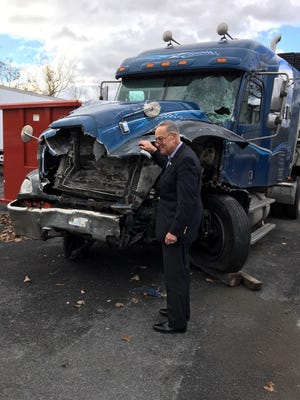 Sen. Charles Schumer stands in front of a tractor-trailer that got into an accident while speeding in Orange County on Wednesday, Nov. 23, 2016.