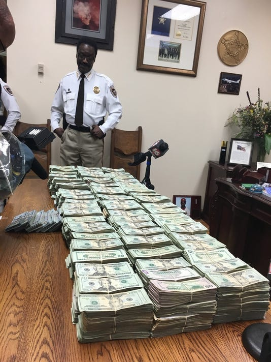 Hinds County Sheriff Victor Mason looks at the more than $1 million seized and later forfeited to Hinds County.