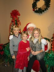 Will, Ellen and Avery  Stuermann meet Santa Clause