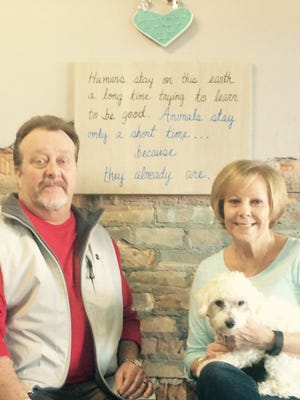 Monte and Barbara Willford are shown at All Hart County Humane Society Community Outreach Center with Luke, a rescued shelter dog.