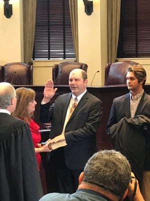Bobby Chamberlin takes the oath of office for the state Supreme Court Tuesday in Jackson, Mississippi.