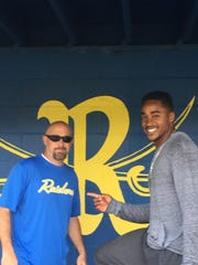 Atlanta Braves outfielder and former Rickards star Mallex Smith, right, with Rickards baseball coach Brian Kelley in the Raiders' dugout Tuesday.