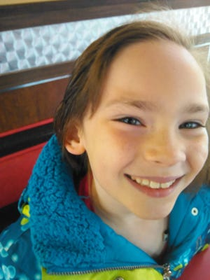 """Hannah Spain, 8, is recovering from open-heart surgery. She and her father are working on a book called """"Hannah's Big Heart."""""""