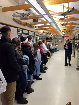 World War II veteran Owen Garrison tell stories of the war in the Pacific to students in Tom DeCou's AP U.S. History class from Millville Senior High School during a visit to the Millville Army Air Field Museum on Dec. 14.