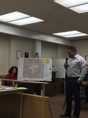 As Mayor Sherry Capello listens, Aaron Camara of Monarch Enterprises explains his plan to build a shopping center between the 9th and 10th street railroad overpasses in Lebanon.