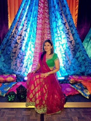 Paola Chavarria is an economist who works directly with the president of Costa Rica as a government advisor. She wore a traditional silk lehenga choli of rich colors which celebrated the vibrant colors of the Indian state of Rajasthan as displayed behind her.