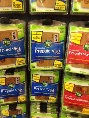 Green Dot cards are on display at a Collierville Walgreens on Wednesday. Cards like this can be misused in scams.