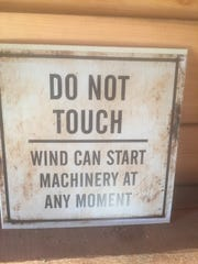 This warning is posted in the mill houses on Jay McGinnis' farm.