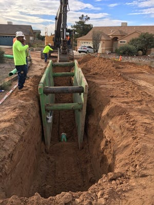 Las Cruces Utilities workers build a trench to install a sewer main line on Windridge Circle as part of the Salopek/Sunrise Subdivision Sewer Improvements Project Phase II.