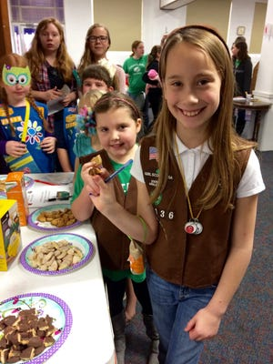 Loudon County Girl Scouts were taste testing Girl Scout Cookies at a recent Cookie Rally. From front to back are Ava Willoughby, Madison Currier, Hope Smiddy, Sophie Calvin, Lilli Cooper and Lauren Kennedy. They voted on the various cookie flavors for this year, and they declared the new cookie, S'mores, to be their favorite.