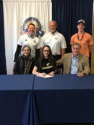Islay Thompson is shown with family and friends signing her national letter of intent to play soccer at Anderson University.