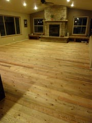 The floor is six-inch wide Flathead Lake circle-saw rough pine in a residential home in Bozeman.