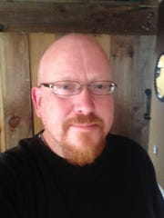 Scott Becker, 46, of Washington Township, suffered