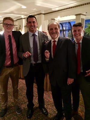 Honoring Fleming: (from left) MKA runner Billy Massey, Giants' Zak DeOssie, Tom Fleming and MKA runner Billy Hughes.