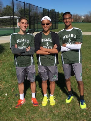 East Brunswick tennis players Isaak Elkind (to the left), Kameron Wang and Renesh Bhamidipati after a match on April 8.
