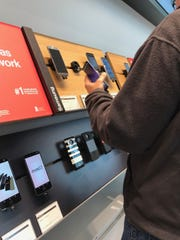 A customer checks out the Samsung Galaxy S8 at a Verizon