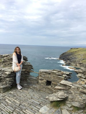 Macie Thompson at Tintagel Castle, which rises above the wild Atlantic Ocean along the Cornwall coast of England.