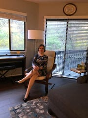 Amanda McGarry enjoys the natural setting she seeks from the balcony (n the background) of her Ramsey condo.